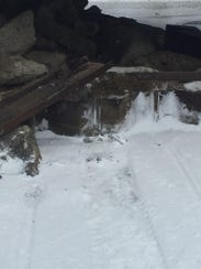 Tracks for a snowmobile can be seen as well as fire