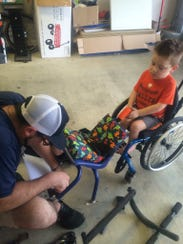 Beau Becton constructs a chair for his son Steele,