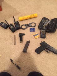 Suspects carried firearms and used surveillance equipment