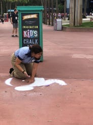 Watch the artists or join the fun with chalk art.