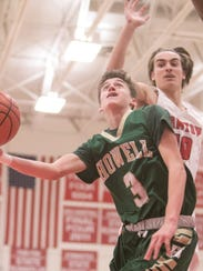 Howell's Kip French shoots in the game against Canton Tuesday, Feb. 20, 2018. Guarding him for the Chiefs is Danny Lanava.