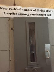 A replica solitary confinement cell is on display at