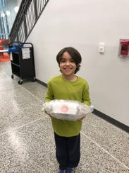 Victorio Perez shows off his successful egg drop contraption.