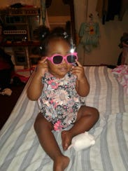 Kaydee Calhoun, an 18-month-old girl, was stabbed in