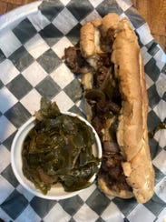 A Philly cheese steak sandwich ($10.99) with a side