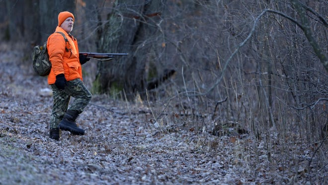 The gun deer season continues as Joe Friebel of Winchester talks with his son, Brian, as they head into the woods to hunt near Fremont, Wis., Saturday, November 28, 2015.