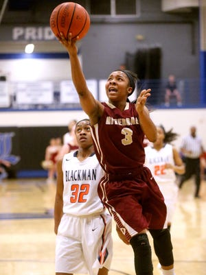 Riverdale's Anastasia Hayes (3) goes up for a shot as Blackman's Crystal Dangerfield (32) watches in the background during the Region 4-AAA girls basketball semifinal game, on Monday, Feb. 29, 2016, at La Vergne.