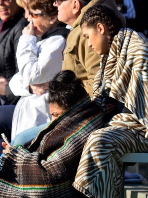 Fans bundle up in blankets as York Catholic faces West York  in boy's lacrosse Tuesday, April 5, 2016. John A. Pavoncello photo