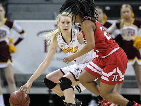 Cooper's Lexi Held tries to work the ball upcourt under pressure from Janice Stovall during Holmes' 58-52 win in the Girls' Ninth Region Basketball Tournament championship game at NKU's BB&T Arena, Sunday, March 5, 2017.