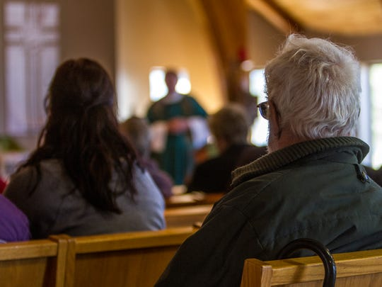 Members of the St. Jude's Episcopal Church attend services on Sunday, Nov. 22, 2015.