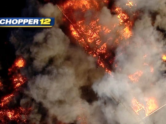 Image from News 12's helicopter shows the massive Hillsborough warehouse fire Thursday, February 11, 2016.