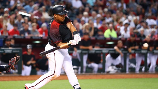 Arizona Diamondbacks outfielder Yasmany Tomas hits an RBI triple in the sixth inning against the Cleveland Indians at Chase Field, Apr. 8, 2017.