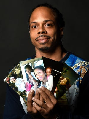Robert E. Polk, a man in jail for two years on false allegations, and whose case has prompted concern about the Tennessee Board of Parole, shows some family photos that gave him comfort while he was in prison