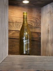 Iron Gate Winery's first bottle of chardonnay sits