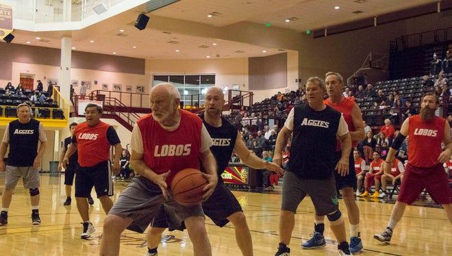 The Senate Lobos play against the House Aggies in the Hoops 4 Hope Legislative Basketball Game.