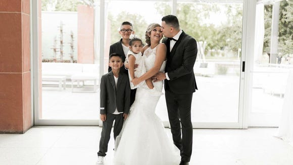 Ashley Lopez of Arizona poses with her three children