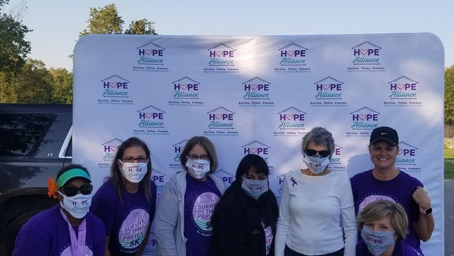 Volunteer committee members for the Hope Alliance Virtual 5K Race pose with Commissioner Terry Cook at San Gabriel Park in Georgetown are, from left, Patricia Fowler, Natalie McKinnon, Tracy Lyke, Priscilla Moreno, Cook, Lesa Cantrell and Jamie Felicia (kneeling).
