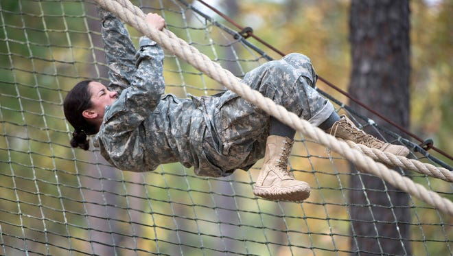 This undated photo released by the Utah National Guard shows 1st. Lt. Alessandra Kirby negotiating the Darby Obstacle Course at Fort Benning, Ga., during the Ranger Assessment. Kirby will be among a handful of women going to the grueling Army Ranger school as part of the U.S. military's first steps toward allowing women to move into the elite combat unit.