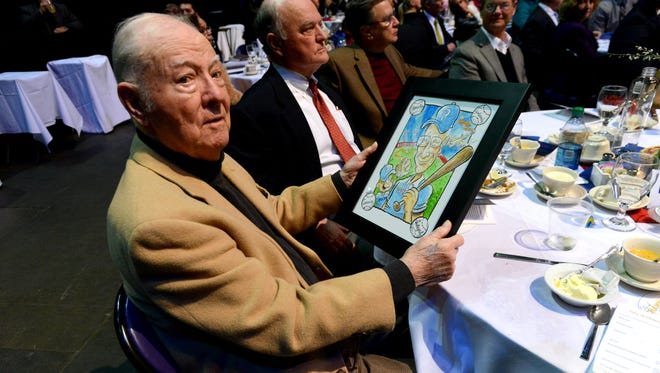 Bill Bond is recognized during the The City of Champions 2015 banquet and celebration and presented with a cartoon by Pensacola News Journal's Andy Marlette on Thursday evening at the Pensacola Bay Center. This year's event was held to honor professional baseball players from the Pensacola area and raise more funds for a Pensacola sports museum.