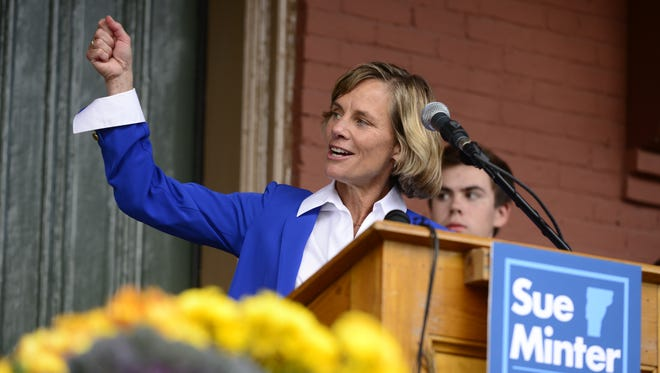 """Democratic gubernatorial candidate Sue Minter raises a """"torch"""" for former Gov. Madeleine Kunin, Vermont's first female governor, at a campaign kickoff Tuesday in Waterbury."""