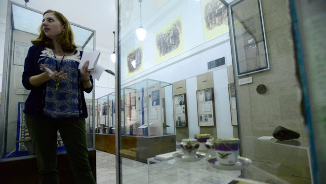Kristina Smith, marketing and communications manager with The Hayes Presidential Center, shows the President's Gallery, which will receive lighting to display artifacts of past presidents.