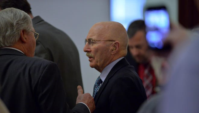 Joseph Campbell talks with his attorney Gregory Jackson during a break in his deliberate homicide trial in February.