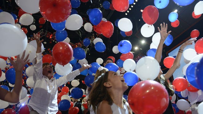 In this Aug. 30, 2012, file photo, hundreds of balloons drop on stage at the Tampa Bay Times Forum in Tampa, Fla., on the final day of the Republican National Convention.