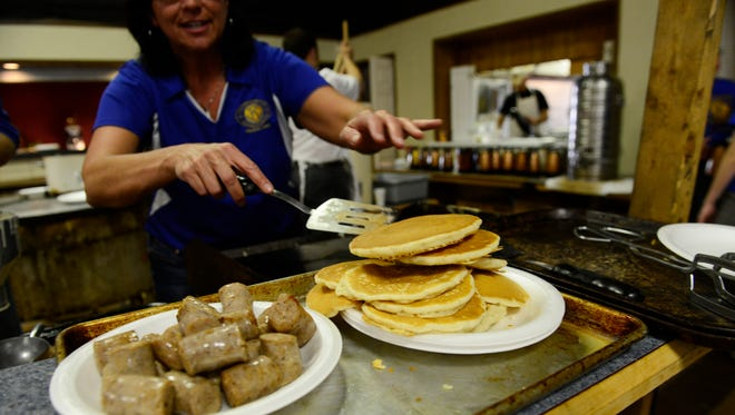 During the Kiwanis Pancake Festival at the American Legion in Fremont on Wednesday afternoon, volunteers served 1,700 pounds of sausage and 12,000 pancakes.