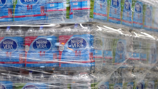 Bottles of water are pictured in the new mineral water bottling plant for Nestle Vera Naturea located in Castrocielo, central Italy, on July 5, 2016.