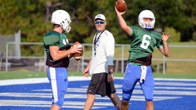 Coach Pete Shinnick checks out his players Saturday, August 12, 2017 during the UWF football practice at Pen Air Field.