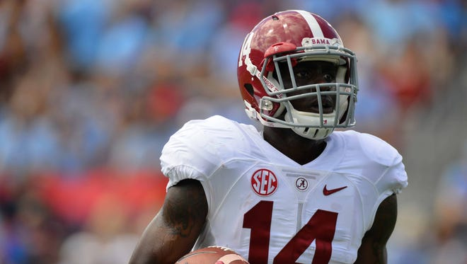 Alabama safety Deionte Thompson and three other men have been indicted on charges stemming from a spring break fight, the Beaumont Enterprise reported Monday.