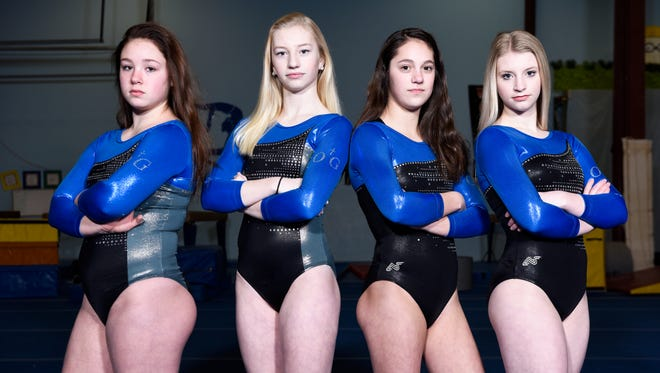O'Gorman's all-around qualifiers, including senior Lizzie Miller (far right) pose for a portrait.