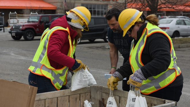 Central Hudson workers gave out dry ice and water to customers Monday at the Home Depot in Poughkeepsie.