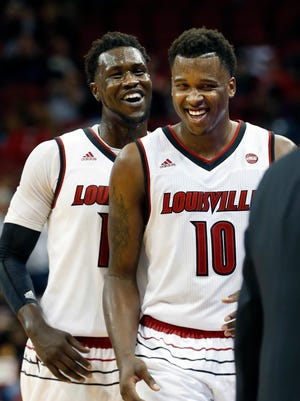 Louisville's Jaylen Johnson (#10) and Mangok Mathiang are all smiles as the exit the game with the Cards up big over Evansville.  