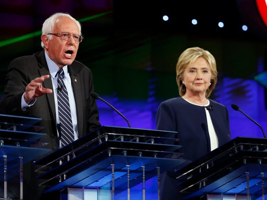 Hillary Clinton and Bernie Sanders participate in the first Democratic debate in Las Vegas on Oct. 13, 2015.