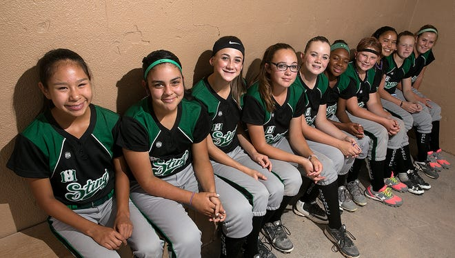 The New Mexico Sting 12U softball team poses for a photo on Tuesday at the Ricketts Park Softball Complex. From left are: Shandiin Harper, 13, Mia Mascarenas, 11, Blaize Bingham, 13, Nicole Brimhall, 13, Taryn Maness, 12, Zoriah Plamer, 13, Madi VanRiper, 12, Delayna Garnenez, 12, Akaysia Grogan, 12, and Ellie Duncan, 11. Not shown are Evany Moreales, 12, and Gerilynn Delegarito, 12.
