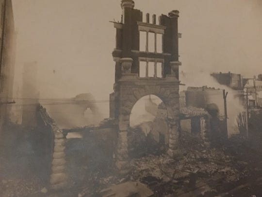 In this photo, smoke is still rising from the ashes of the Baldwin Theatre at 322 St. Louis Ave.  It was built in 1891 and was destroyed on Jan. 6, 1909.