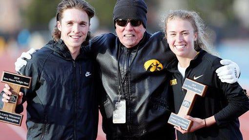 Winners of the Larry Wieczorek 1,500-meter run: Iowa juniors Nathan Mylenek and Megan Schott, with Wieczorek.