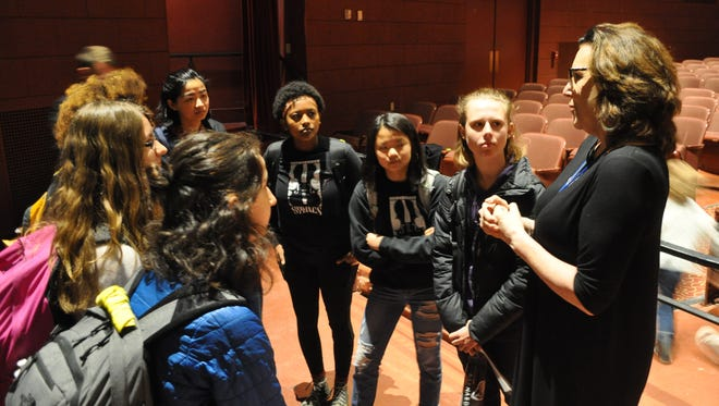 Journalist Joan Walsh talks with students who helped to organized the 50 Miles More march from Madison to Janesville, Congressman Paul Ryan's hometown, in March.