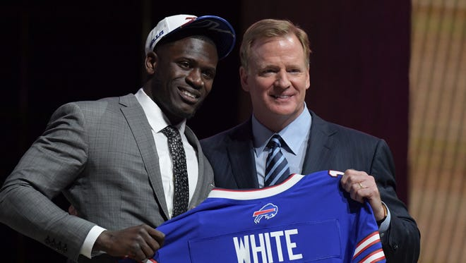 Apr 27, 2017; Philadelphia, PA, USA; Tre'Davious White (LSU) poses with NFL commissioner Roger Goodell (right) as he is selected as the number 27 overall pick to the Buffalo Bills in the first round the 2017 NFL Draft at the Philadelphia Museum of Art.