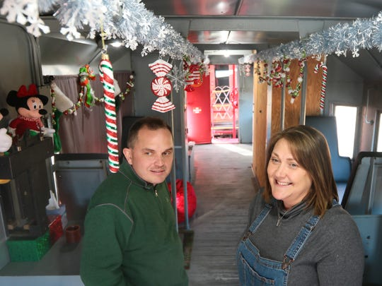 Steven and Cheryl Hawkins, of Greenville & Western Railway Company,  prepare for the Santa Express in Belton.