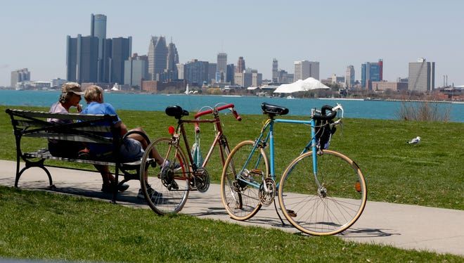 (L to R) Cathy Bereza and husband Bob Dodd of Oxford, Mich. relaxing on a bench on Detroit's Belle Isle on Tuesday, May 1, 2018.