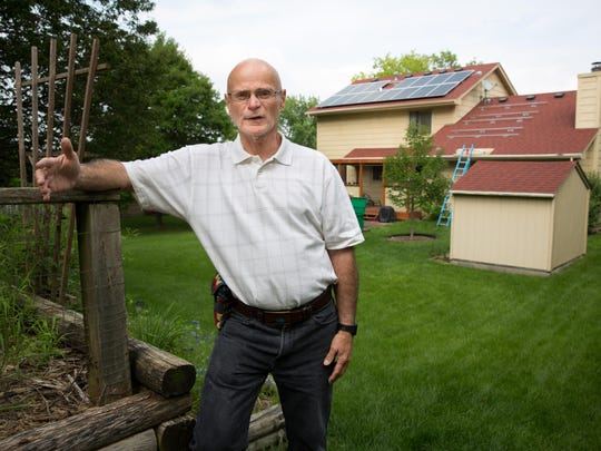 Bob Bernard has nine solar panels mounted to his house in Urbandale in 2015 to go with the 15 panels previously installed.