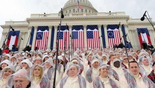 Choir members wear head covering before the inauguration ceremony.