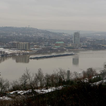 Two barges make their way along the Ohio River on Wednesday