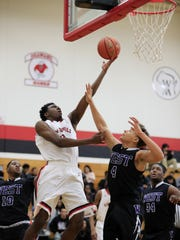 Former Green Bay East standout Zack Crockett (2) was a first-team all-conference selection in the Bay as a senior in 2016-17.