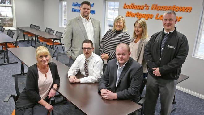 Some employees at Bailey and Wood Financial Group (from left sitting) Tawn Hensley, Eric Lyon and Mike Wood and (from left standing) Chad Terhune, Courtney King, Cat Collins, and Grant Lyons are shown in the company's Whiteland offices on March 3, 2016.