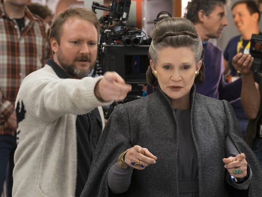 Director Rian Johnson goes over a scene with Carrie Fisher on the set of 'Star Wars: The Last Jedi.'