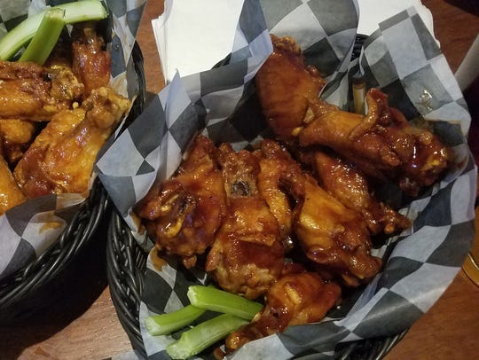 Maple BBQ, left, and Thai BBQ chicken wings at McGillicuddy's