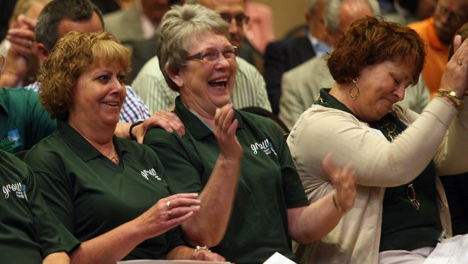 Members of the Grow Greene County Gaming Corp., from left, Brenda Muir, Mary Jane Fields, and Lori Mannel, react to the 3-2 vote by the Iowa Racing and Gaming Commission to award a casino license to the group during a meeting Thursday, June 12, 2014, in Burlington, Iowa.